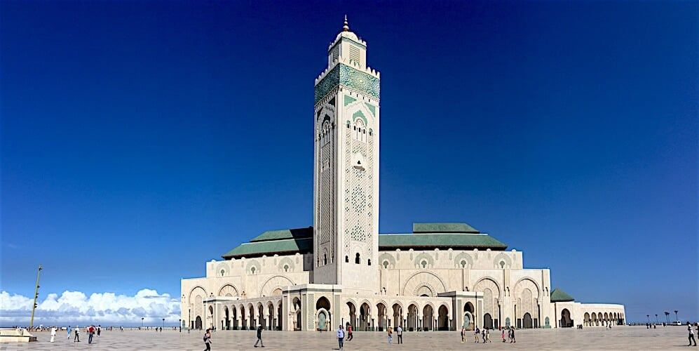 The beautiful Hassan II mosque in Casablanca in front of clear blue skies.