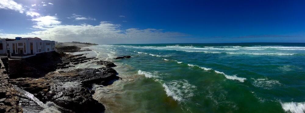 Waves of the Atlantic ocean crashing into the rocks of Asilah