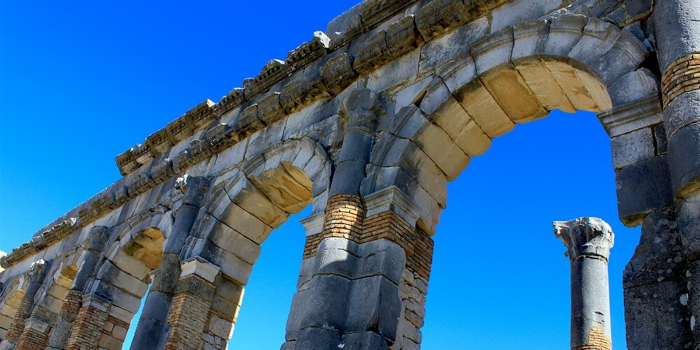 Arches of the Roman ruins under clear skies