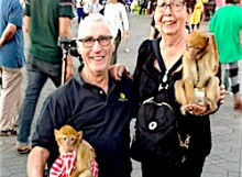 Couple posing with monkeys in Marrakech square