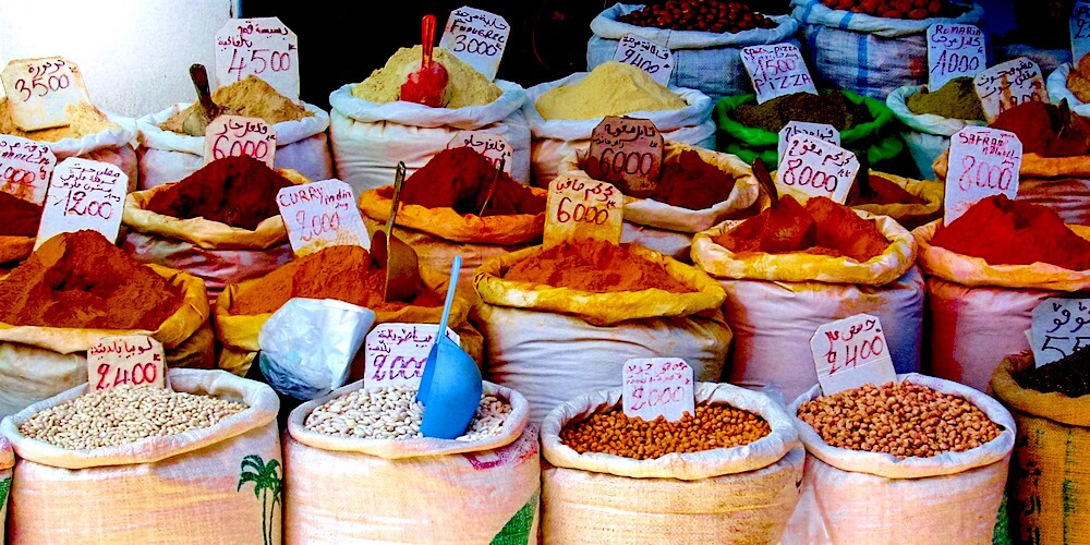 Sacks of Moroccan spices and dried ingredients on display for sale