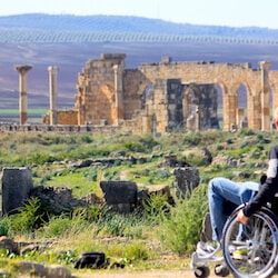 Man in wheelchair in front of Volubilis